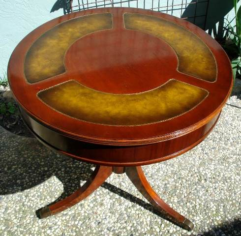Duncan Phyfe style mahogany drum table with leather inlaid top