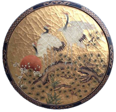Japanese circular lacquer painting depicting white cranes on a pine tree