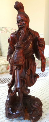 Antique rosewood sculpture of a Chinese Old man with a fish