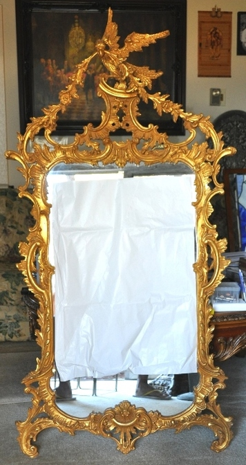 Mid-century Italian mirror in gilded wood carved ornate frame with Phoenix