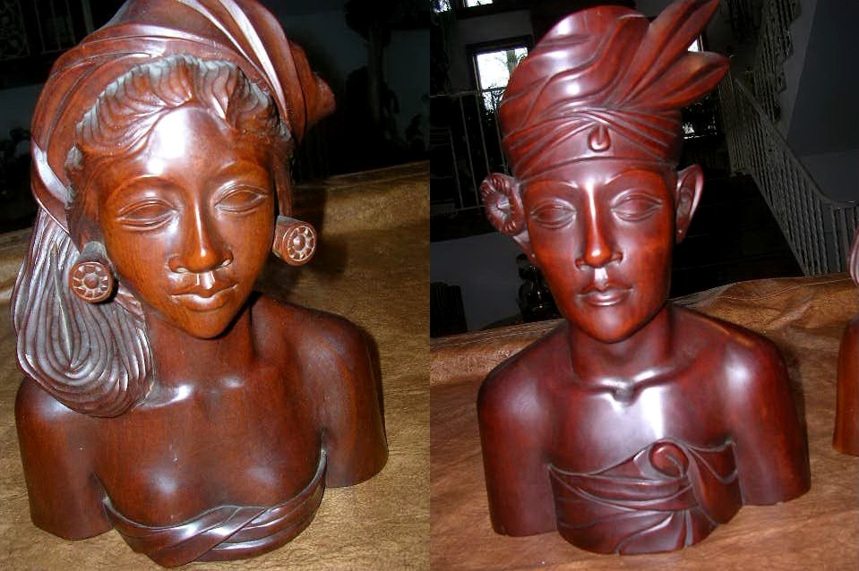 Large ironwood sculptures of man and woman from Bali, Indonesia