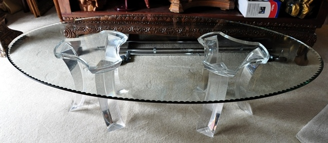 Oval glass top modern coffee table with acrylic pedestals