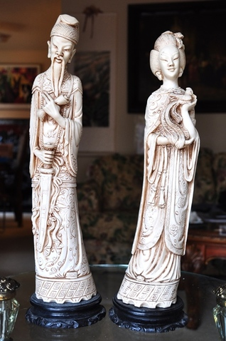 Faux ivory statues of Asian emperor and empress