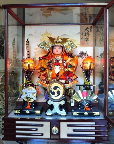 Large Japanese Samurai doll with music box in glass case