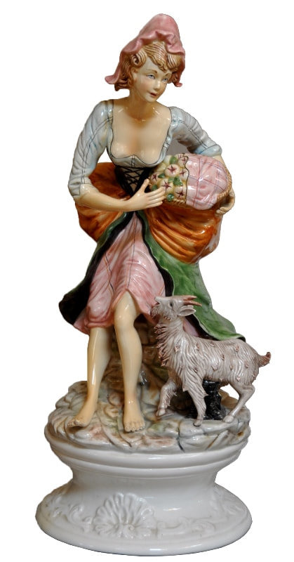 Vintage porcelain sculpture of a peasant girl with her goat