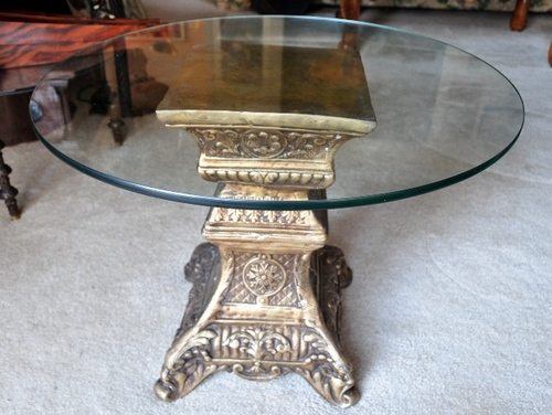 Indian antique end table with ornate brass pedestal base and glass top