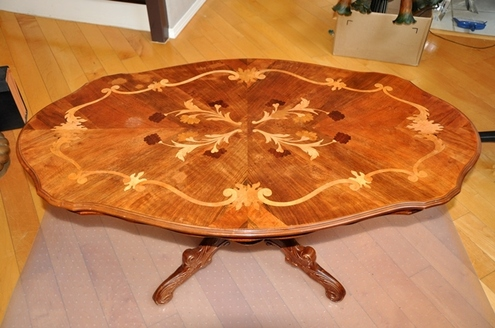 Italian coffee table with ornate pedestal and floral marquetry inlaid top