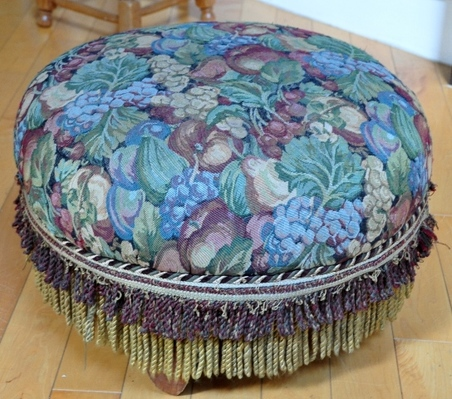 Colorful tapestry upholstered round Ottoman with fringe