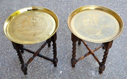 Pair of Asian end tables with engraved brass tray tops and wooden folding bases