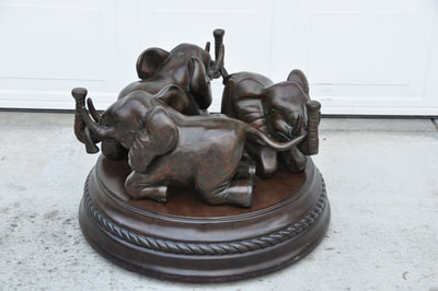 Bombay Company Glass Top Coffee Table With 3 Elephant
