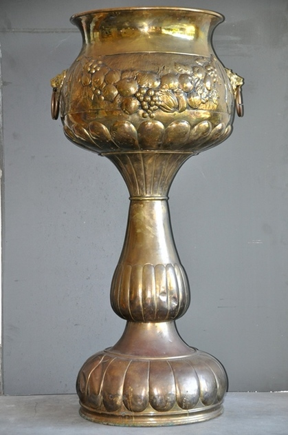 Huge brass Jardiniere planter stand with repoussé decorations and lion head handles