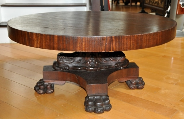 American Empire style pedestal coffee table with lion claw feet and carved dolphins