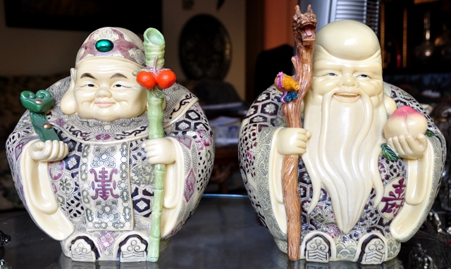Pair of faux ivory sculptures of Shou Lao and another immortal