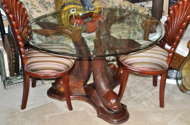 http://www.assamika.com/2014-02-14-carved-teak-wood-koi-fish-base-dining-table-and-shell-shaped-chairs-from-indonesia.html