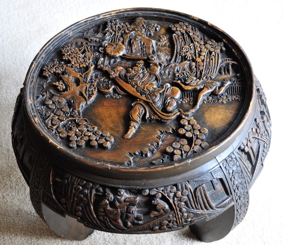 Antique Chinese accent table with 3D relief wood carvings