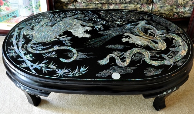 Vintage Korean lacquer coffee table with mother of pearl inlay patterns of tiger and dragon