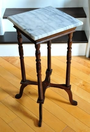 Marble top pedestal with turned wooden legs