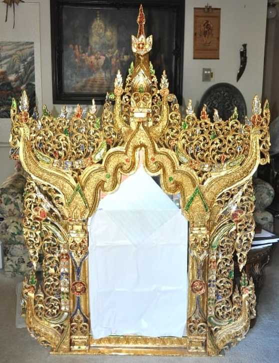 Ornate gilt wood Thai mirror inlaid with colored mirrored glass pieces