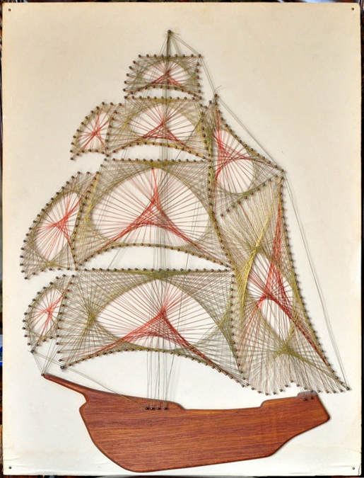 Metal wire string artwork on board of a sailing ship