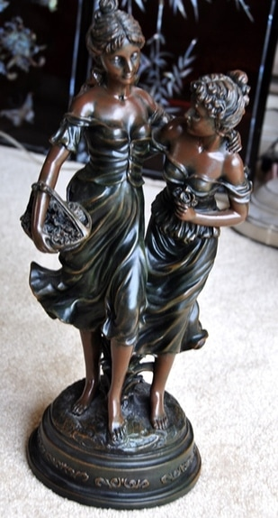 Replica sculpture of Two Sisters by Auguste Moreau