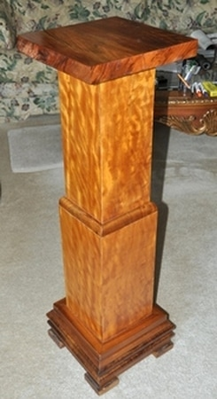 Antique wooden pedestal with square crosss section