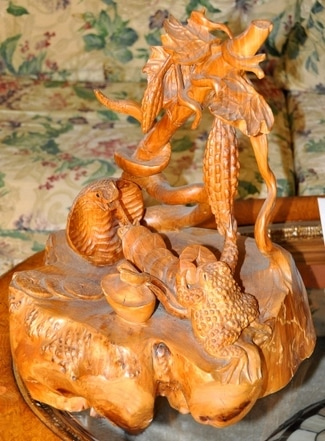 Burl wood sculpture of cobra and frog with gold coins