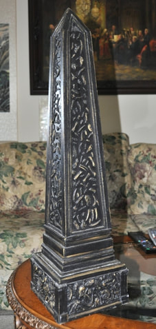 Wooden obelisk with 3D relief features