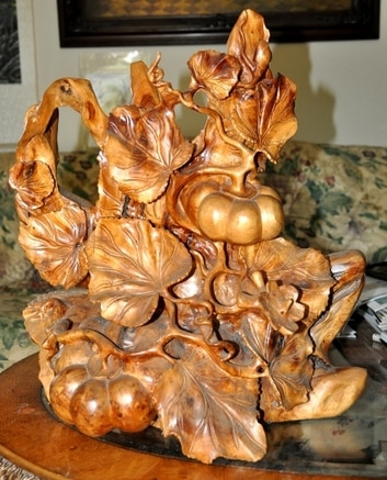 Pumpkins on vine sculpture carved from a single piece of wood