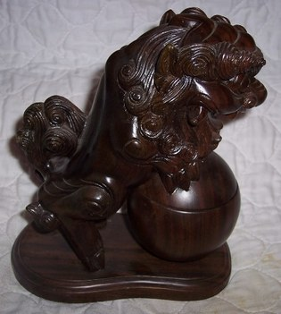 Wood sculpture of Foo dog censer with pearl of wisdom