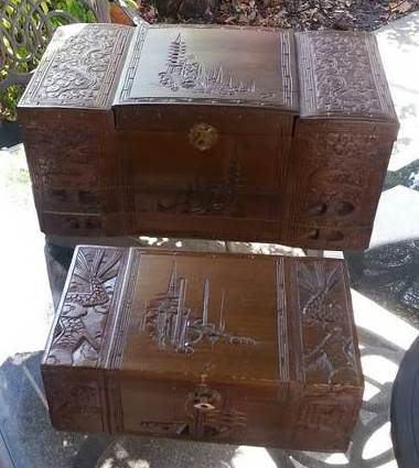 Pair of antique Oriental wooden jewelry boxes with carved artwork