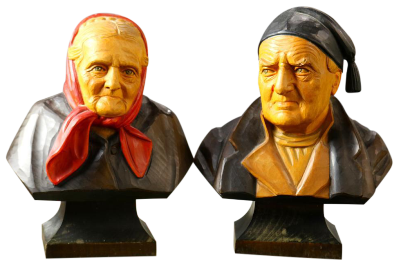 Pair of Hans Huggler-Wyss polychrome decorated carved wood busts of a man and a woman