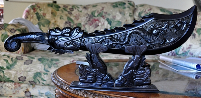 Carved wooden sword with dragon and Koi fish sculpture