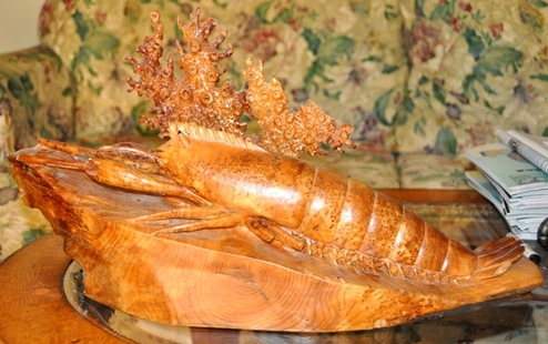 Lobster sculpture statue carved from a single piece of burl wood