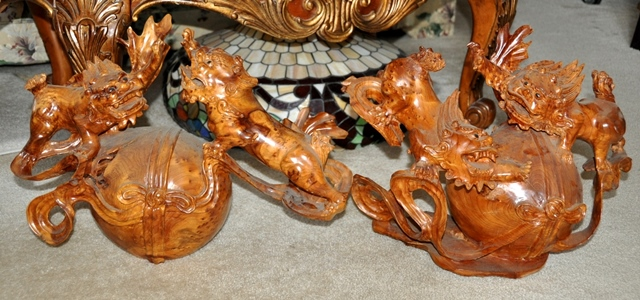Pair of Burl wood carved Chinese sculptures of two Foo dogs on a large ball