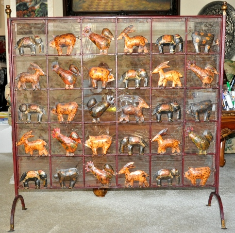 Rare French countryside fireplace screen with animal figure motifs