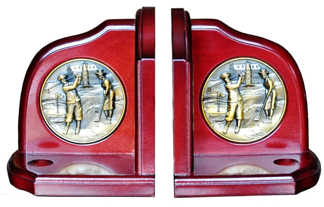 Pair of cherry colored wooden bookends with golf player medallions