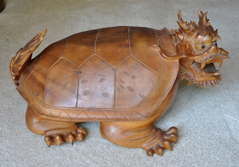 Large wood carved sculpture of a dragon turtle