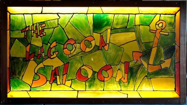 Vintage faux stained glass lighted sign of The Lagoon Saloon bar of San Mateo, California