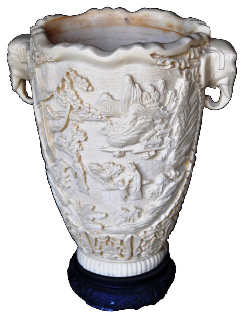 Antique faux ivory vase with 3D relief carvings and elephant head handles