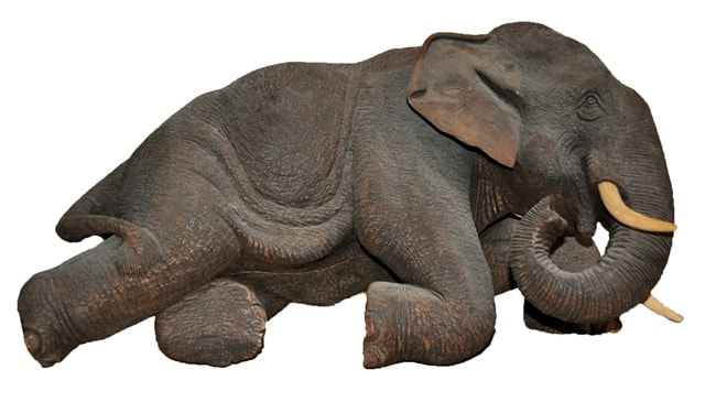 Teak wood elephant with realistic skin texture carved in Thailand
