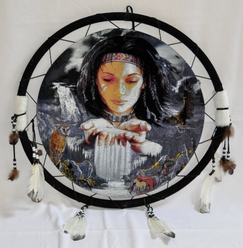 Navajo shield with painting of a woman holding water, birds and animals