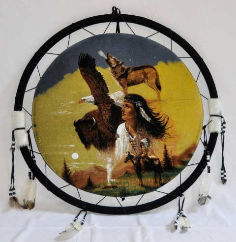 Native American dreamcatcher with painting of a woman, a chief, birds and animals