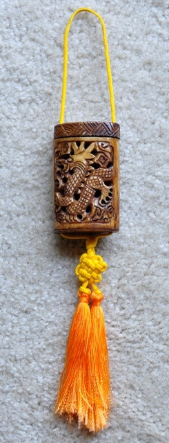 Japanese bone inrō with carved dragon and tassels