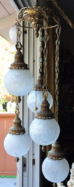 Hollywood Regency chandelier with 5 hanging glass globe lamps