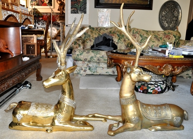 Pair of large brass statues of reclining deer