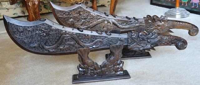 Pair of Vietnamese carved wooden swords with dragons on Koi fish stands