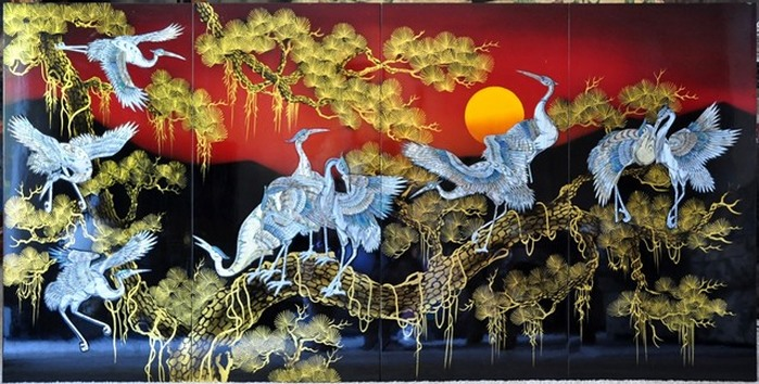 Vietnamese mother of pearl lacquer painting depicting white cranes on a pine tree