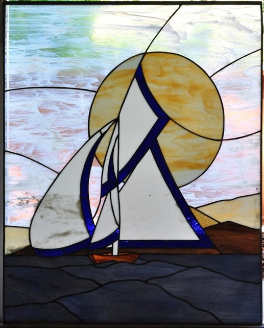 Stained glass window showing a sailing ship in the ocean