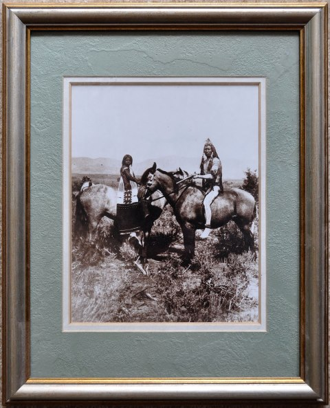 Framed photo titled Ute Warrior and Bride taken by John Hillers in 1874