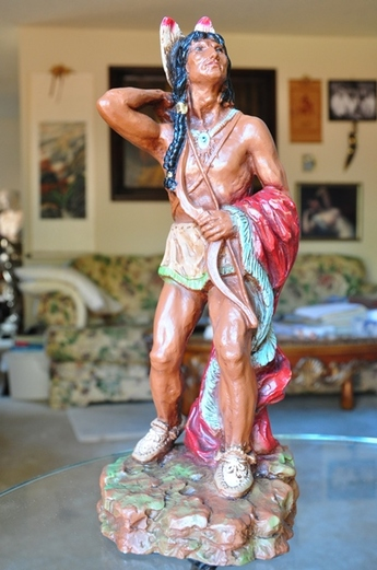 Sculpture of an Native American with bow and arrows